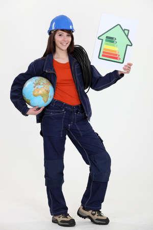 female heating engineer holding globe photo