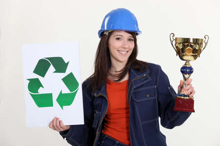 Woman holding trophy and recycle logo photo