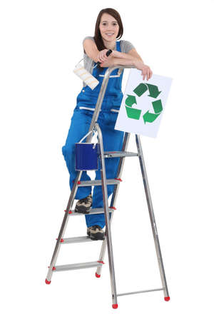 Female decorator holding recycle sign Stock Photo - 13867785