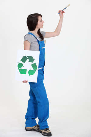 Painter with a recycle sign photo