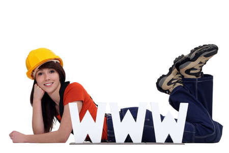 craftswoman posing behind a WWW ad Stock Photo - 13867815