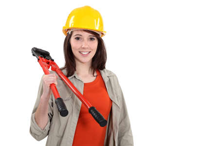tradeswoman: Young tradeswoman holding large clippers Stock Photo