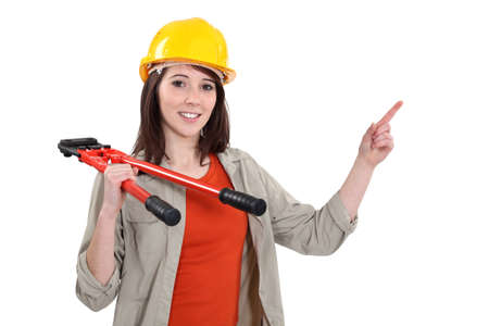 Woman with bolt-cutters pointing Stock Photo - 13867897