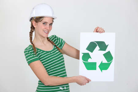 Woman with sign and recycling symbol photo