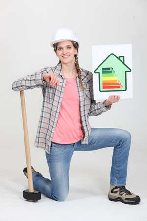 A female construction worker promoting energy savings. photo