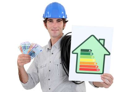 Man holding energy-rating poster and cash photo