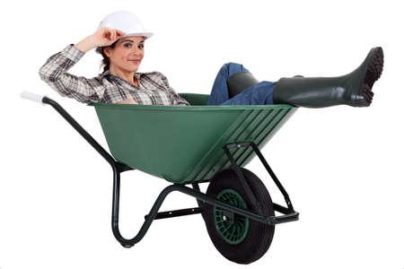 aplomb: Woman in a wheelbarrow