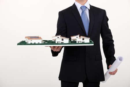 Architect holding scale model of housing photo