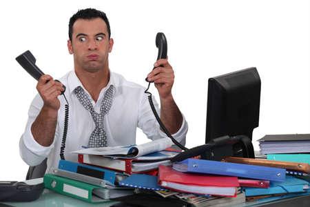 under pressure: Overworked businessman Stock Photo