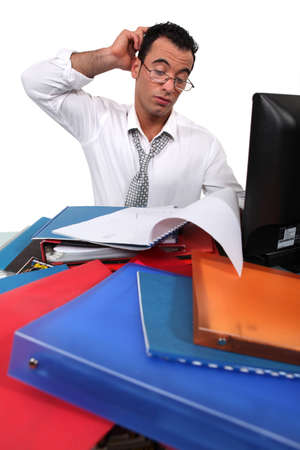 Office worker surrounded by paperwork photo