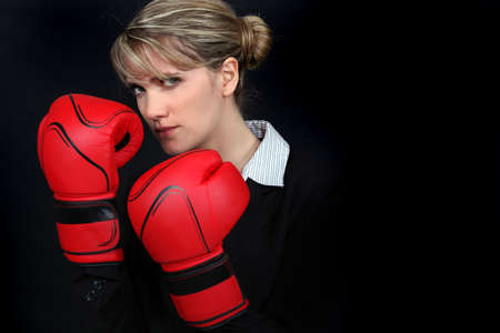 threatening: Woman with boxing gloves