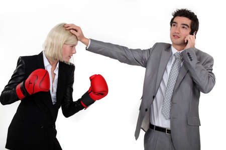 Businesswoman boxing a man on the phone photo