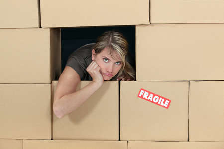 Woman surrounded by cardboard photo