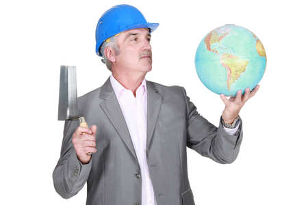 Engineer with a globe Stock Photo - 13868278
