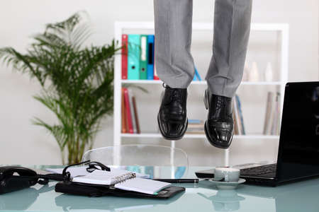 hangup: Businessman hanging from ceiling