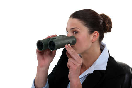 intrude: Office worker with a pair of binoculars Stock Photo