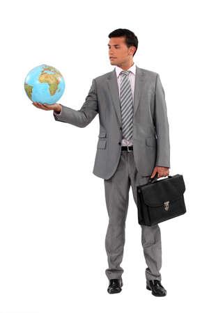 online internet presence: Businessman holding globe