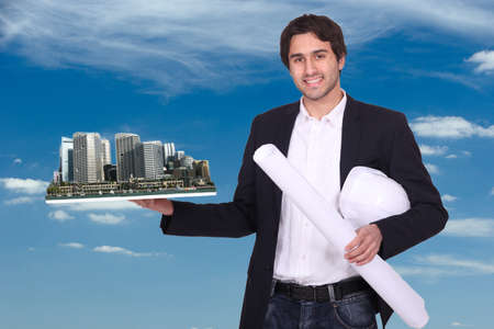 Engineer holding a model of a city Stock Photo - 13868810