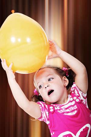 Little girl holding balloon photo