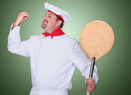 Portrait of a pizza maker photo