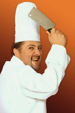 Menacing butcher holding meat cleaver photo
