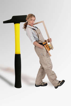 craftswoman leaning on a mega hammer photo