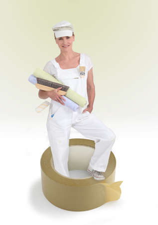 Female decorator holding rolls of wallpaper photo