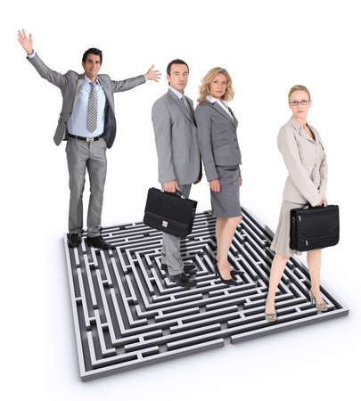 Businesspeople stood by maze photo