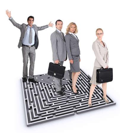 Businesspeople stood by maze photo