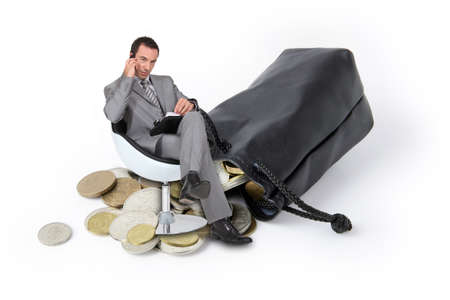 Businessman with pouch full of coins photo