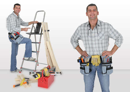 Carpenter stood with ladder photo