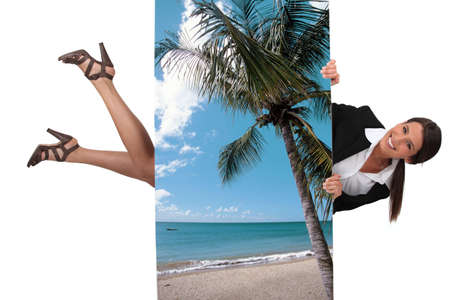 travel agent: cute female travel agent flying under poster of beautiful island