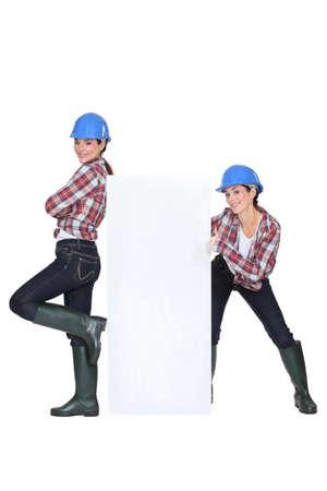 transmitting: Female builder Stock Photo