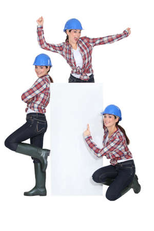 Happy handywoman, studio shot Stock Photo - 13868116