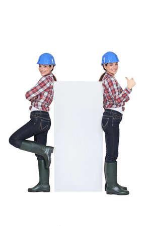 servicewoman: Mirror image of female builder