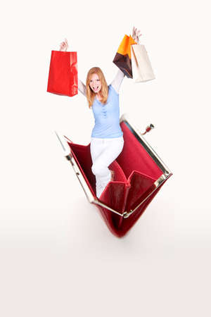 spendthrift: blonde with shopping bags jumping out of purse