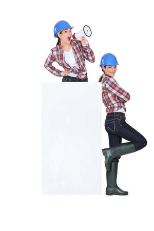 Twins around a blank sign Stock Photo - 13867819