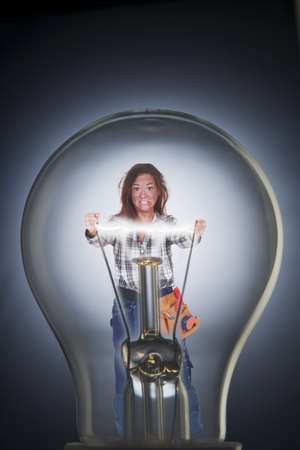 Woman inside a light bulb photo