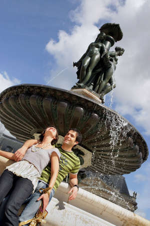Young couple by fountain Stock Photo - 13867181