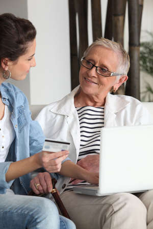 Mother and daughter shopping online Stock Photo - 13862478