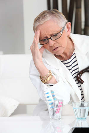 Older woman with a headache Stock Photo - 13867354