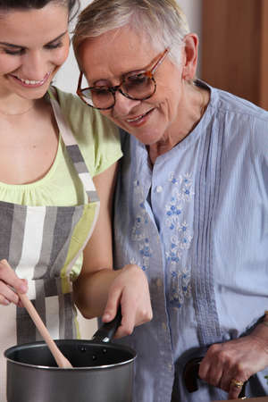 Help senior in the kitchen Stock Photo - 13867424
