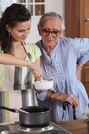homecare: homecare cooking for senior woman Stock Photo