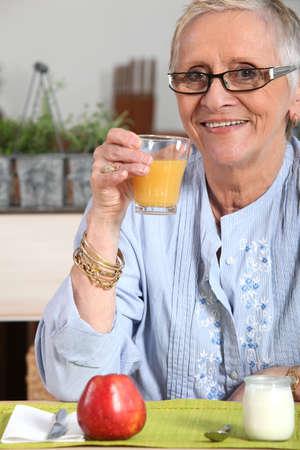 everyday: senior woman having breakfast