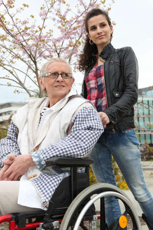 handicapped accessible: Pushing grandma in wheelchair