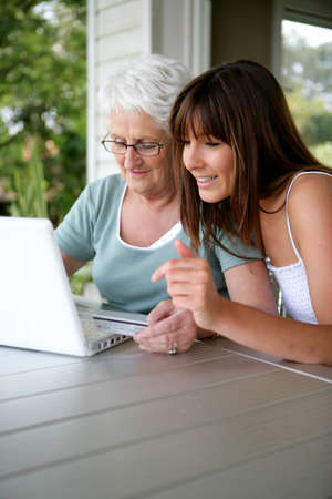 Mother and daughter using laptop Stock Photo - 13875729