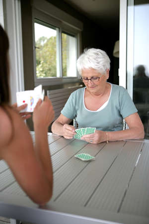 Mother and daughter playing cards photo