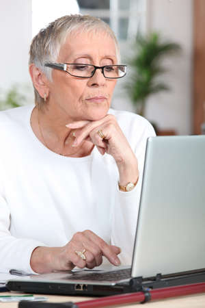 mature woman laptop photo