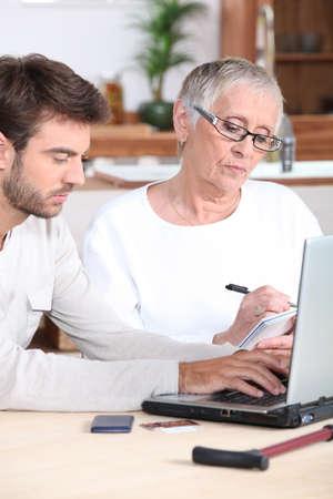 Man helping elderly lady photo