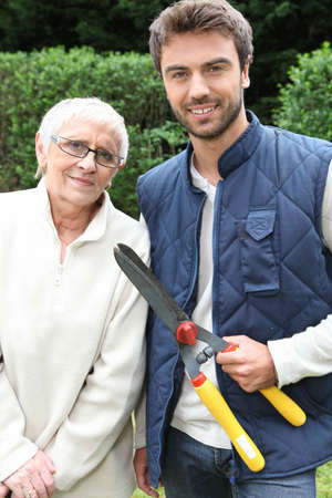 young man and older woman in garden photo